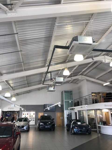 Ceiling air conditioning in car showroom