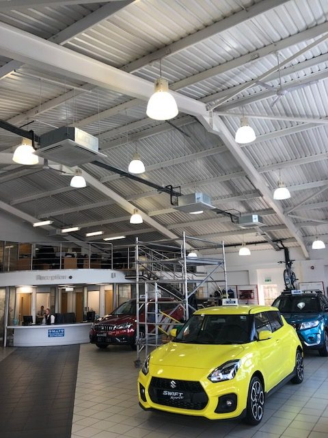 Ceiling air conditioning units in a car showroom