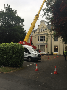 Air conditioning equipment being crane lifted into place